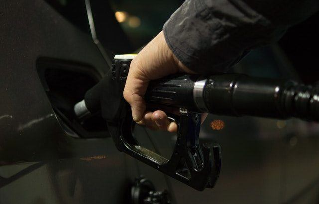 A photography of someone filling their car up with fuel