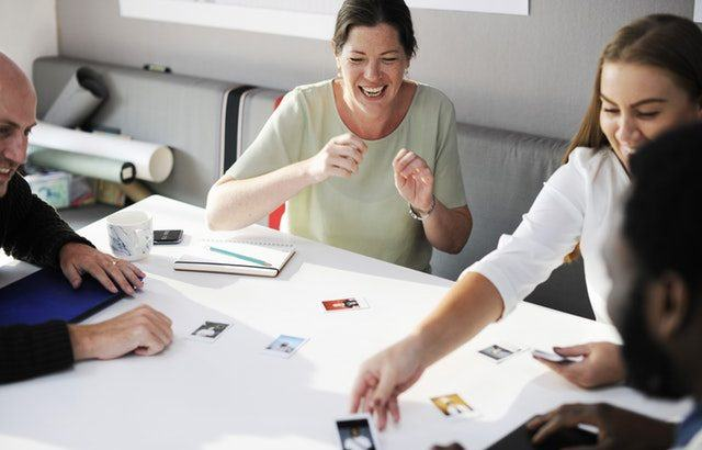 A photograph of people in an office environment looking happy | Smarter Travel Limited