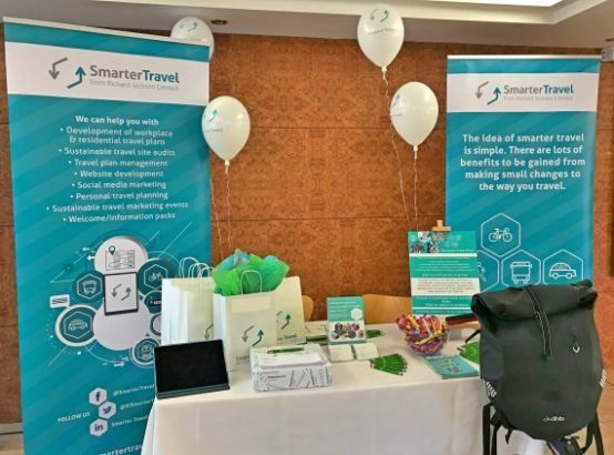 A photograph of the Smarter Travel stand at the event, including pop up banners and balloons